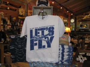"Visit Doc's online store to get the latest B-29 Doc gear. The ""Let's Fly"" t-shirt would be a perfect match for a new Doc hat!"
